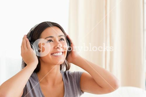 charming woman with earphones