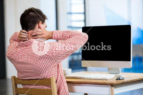 Tired man sitting in front of pc