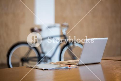 Laptop and file on desk