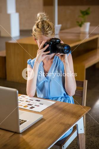 Woman clicking photo from camera