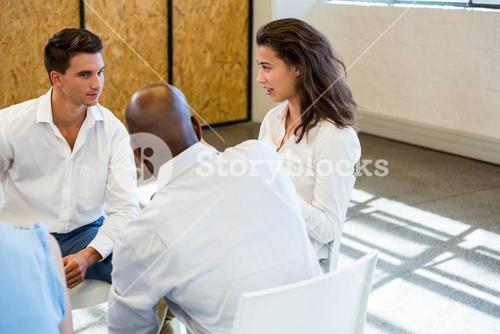 Colleagues comforting a unhappy woman