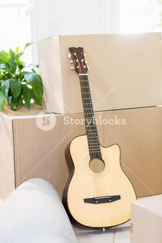 Guitar and cardboard boxes