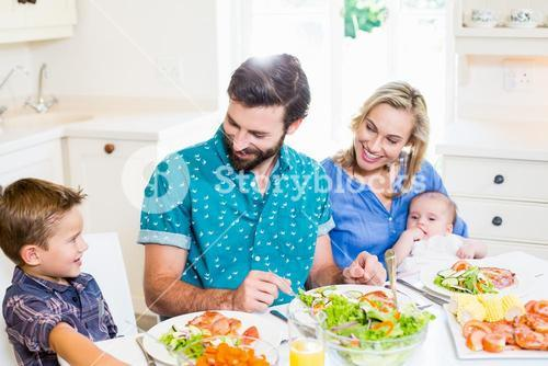 Family having meal in kitchen