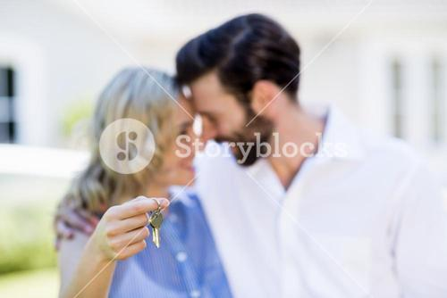Couple holding house key