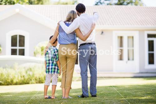 Parents and son standing in garden