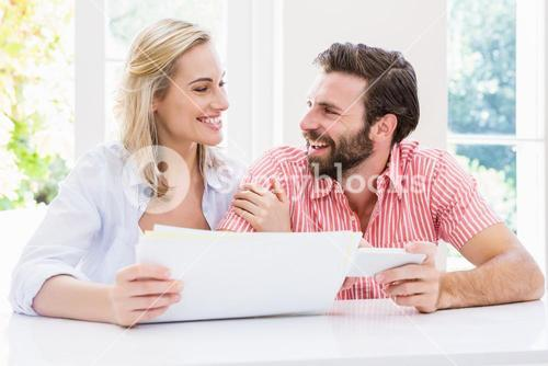 Smiling couple checking their bills