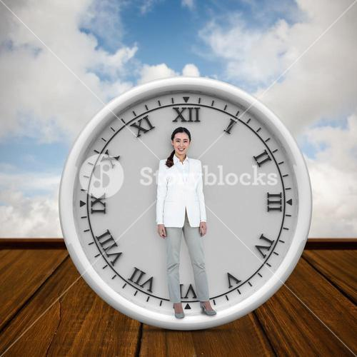 Composite image of smiling businesswoman standing straight up
