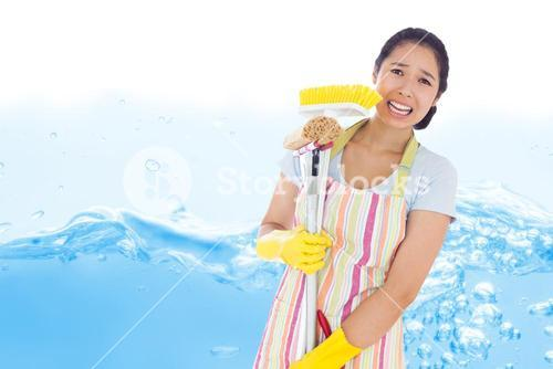 Composite image of distressed woman holding cleaning tools