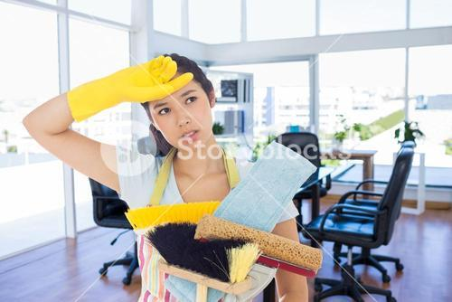 Composite image of weary woman holding cleaning tools