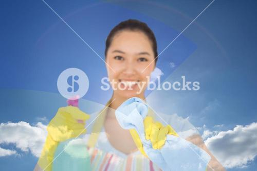 Composite image of happy woman wiping in front of her