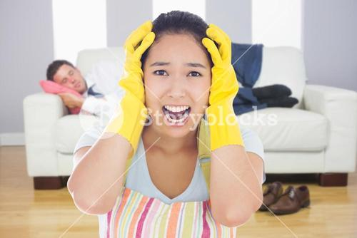 Composite image of distressed woman wearing apron and rubber gloves