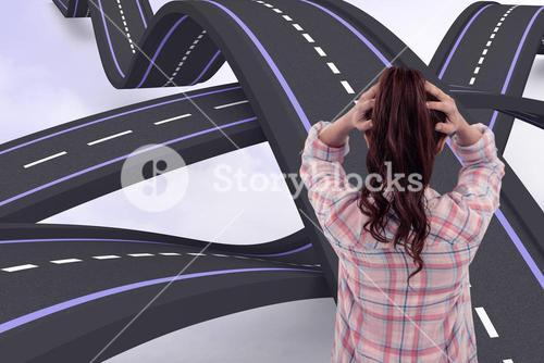Composite image of brunette with hands on hair in front of sticky notes on wooden wall