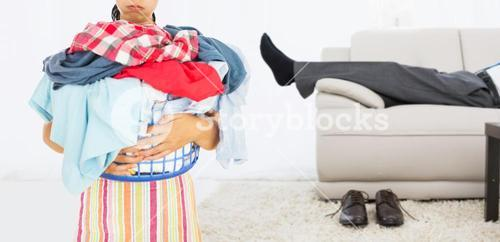 Composite image of tired woman holding full laundry basket