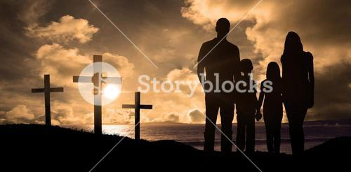Composite image of cheerful family holding hands