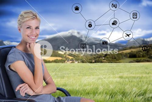 Composite image of portrait of smiling businesswoman sitting on chair