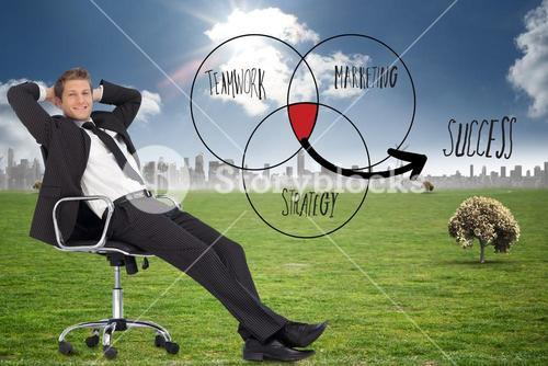 Composite image of businessman relaxing in swivel chair