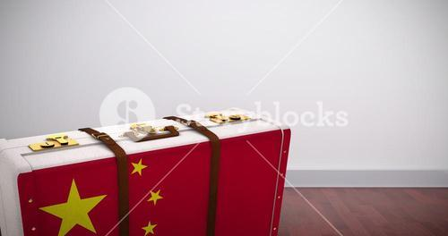Composite image of chinese flag suitcase