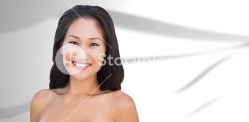 Composite image of smiling sensual nude brunette posing