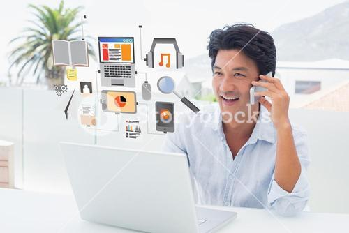 Composite image of smiling man using his laptop and talking on phone