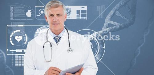 Doctor looking at camera and holding tablet