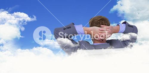 Composite image of relaxed businessman extended on a chair