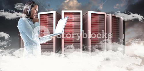 Composite image of businesswoman with finger on cheek using laptop