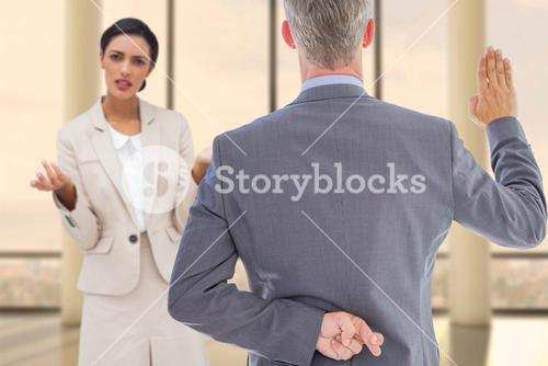 Composite image of rear view of businessman taking oath with fingers crossed