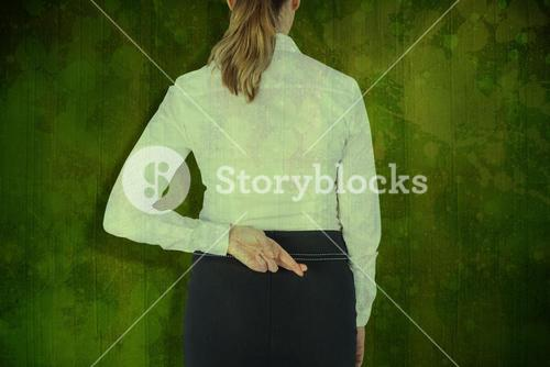 Composite image of rear view of businesswoman with fingers crossed over white background