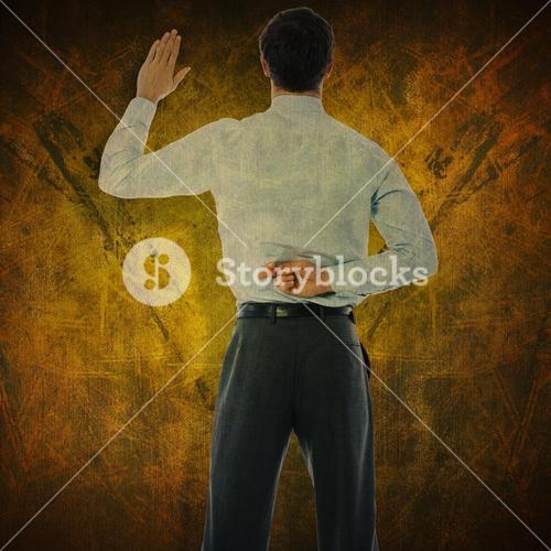 Composite image of businessman crossing fingers behind his back