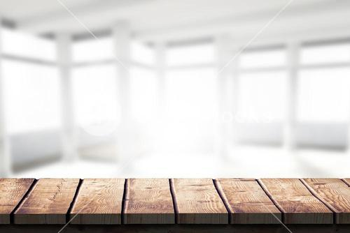 Composite image of wooden desk