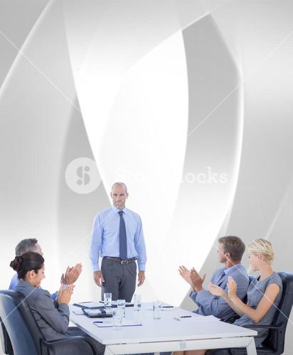 Composite image of business people applauding during meeting
