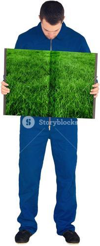 Man holding lawn book