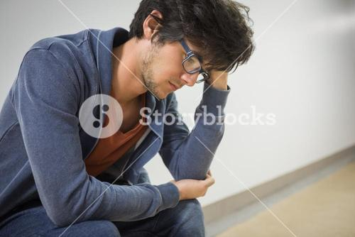 Thoughtful student sitting on chair