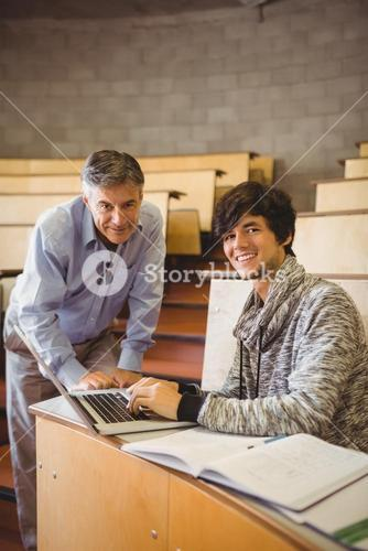 Portrait of smiling student with professor