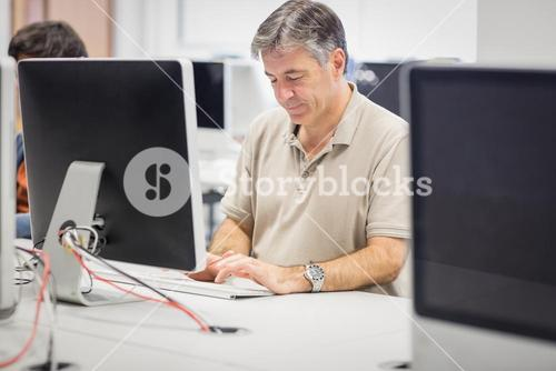 Professor working on computer