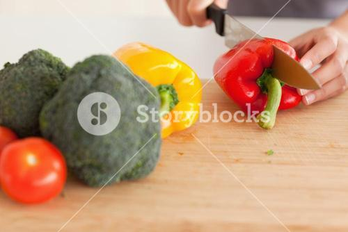 Woman hands cooking vegetables while standing