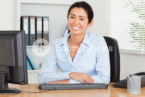 Attractive woman posing while sitting