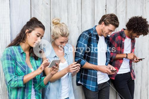 Friends using mobile phone