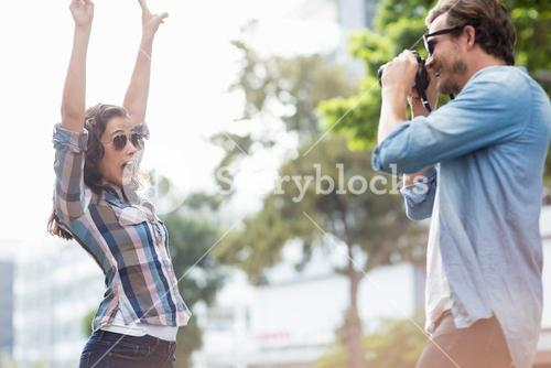 Man taking a photo of his woman