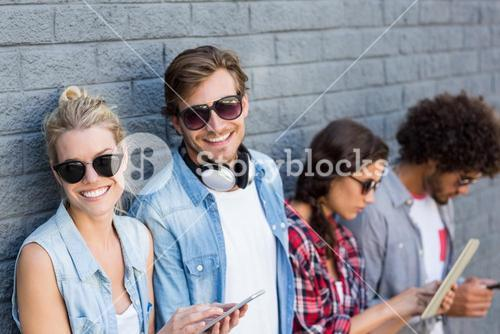 Friends leaning against wall