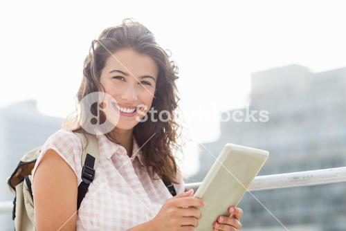Young woman using digital table