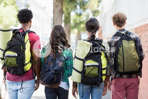 Friends standing with rucksack