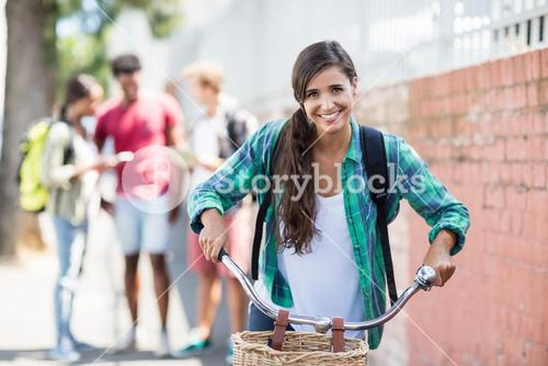 Portrait of young woman riding a bicycle