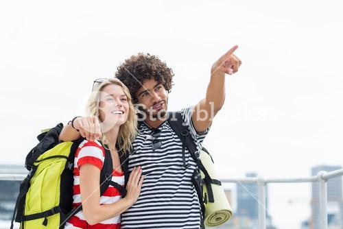 Man standing with woman pointing upwards