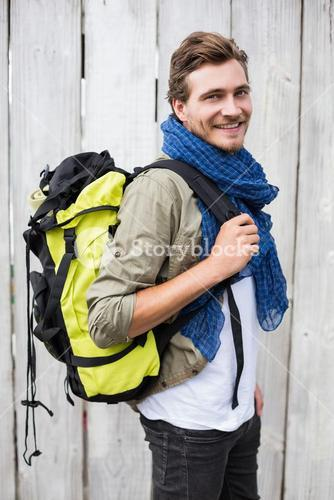 Young man carrying backpack