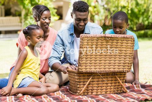 Happy family looking the wicker basket