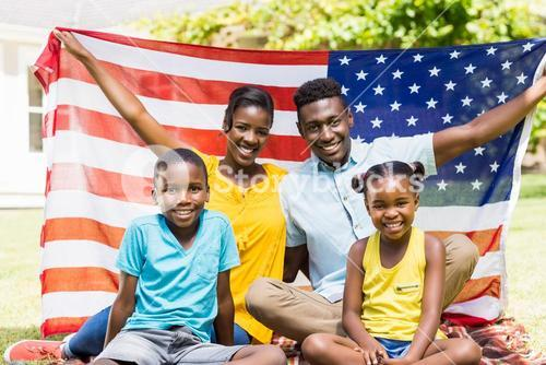 Happy family showing usa flag