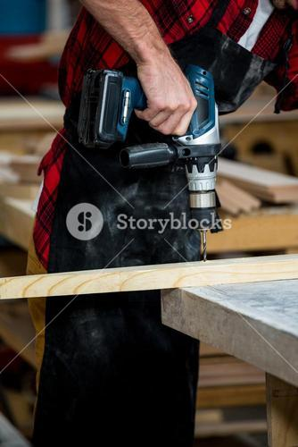 Carpenter using a drill