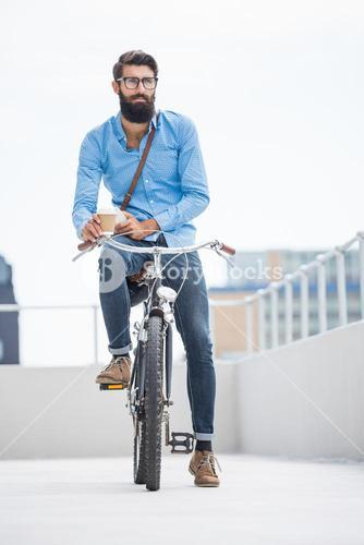 Hipster posing on his bike