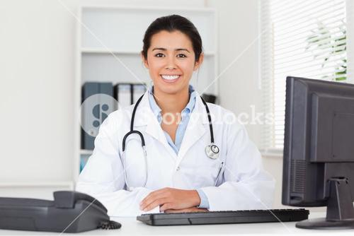 Pretty woman doctor with a stethoscope posing